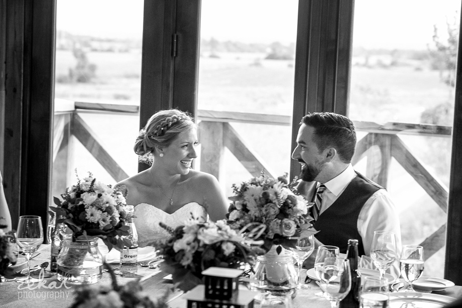 bride and groom laughing at reception