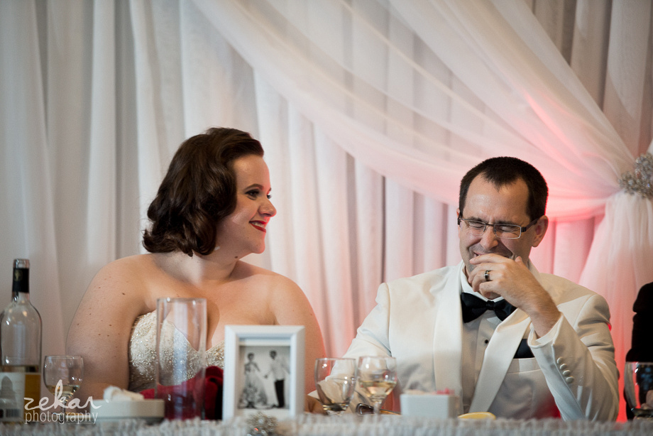 bride and groom laughing at dinner table