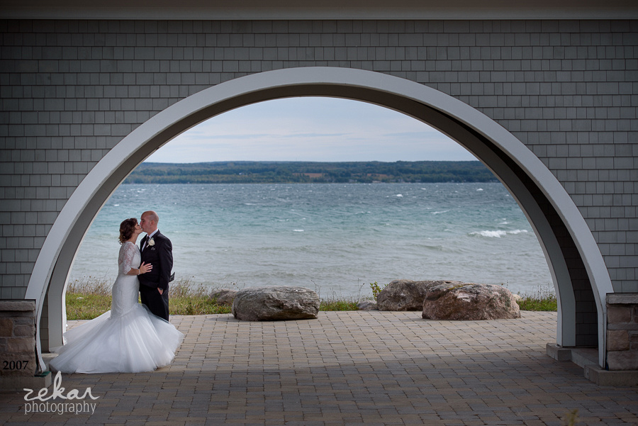 bride and groom under alcove