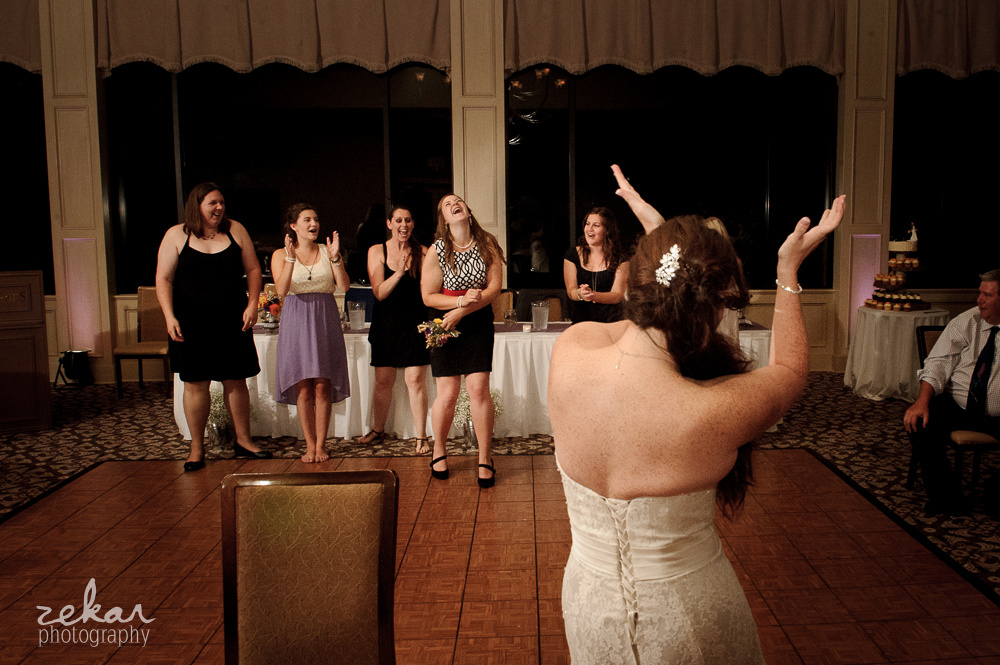 bride tossing bridal bouquet