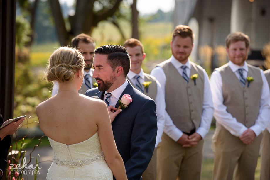 bride fixing grooms corsage