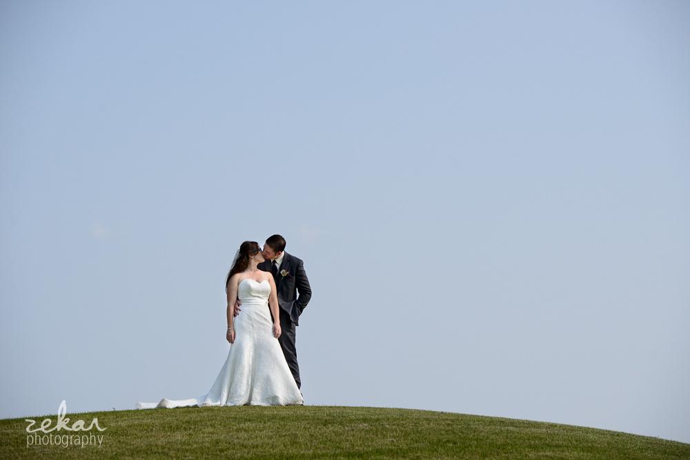 couple on a hill plain sky