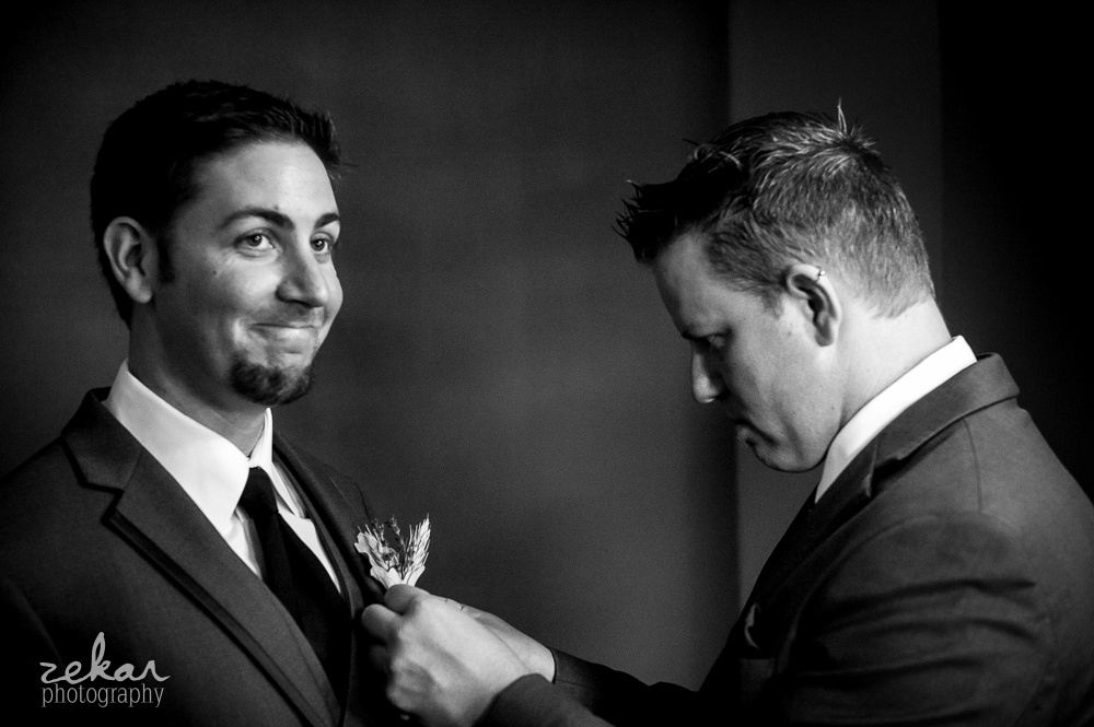 groom getting corsage on