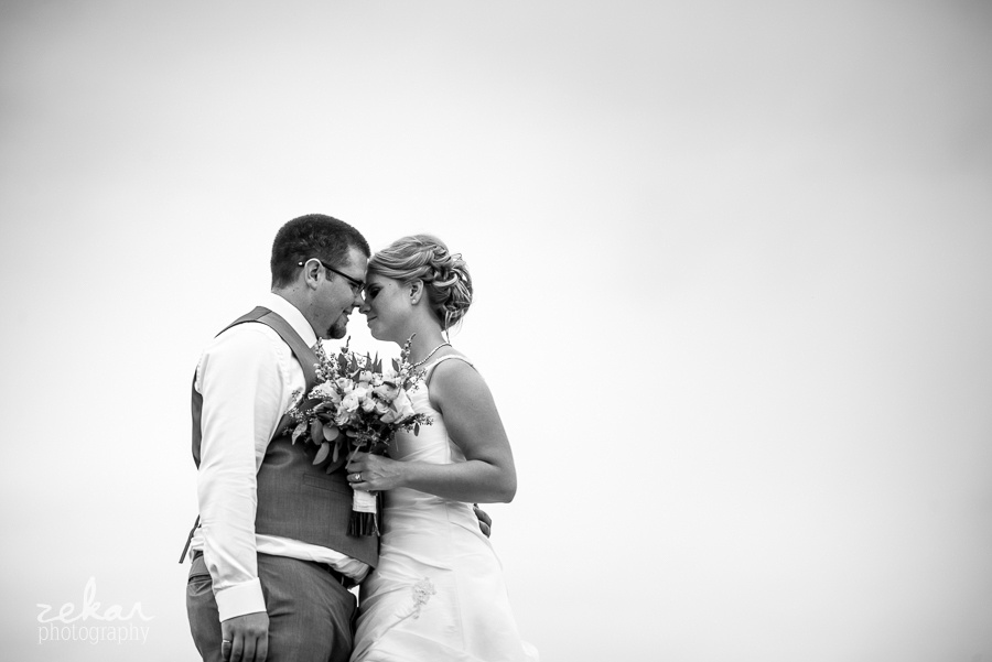black and white photo of couple snuggling