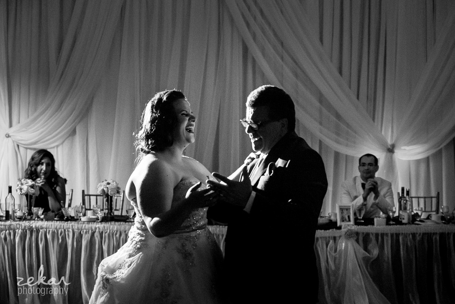 bride laughing with father