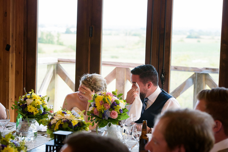 bride and groom crying