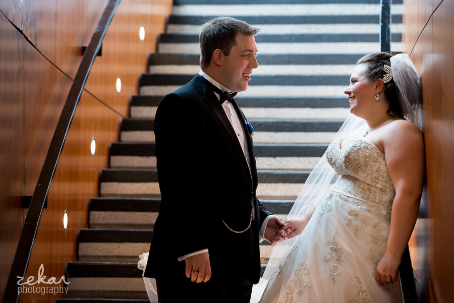 bride and groom by stairs