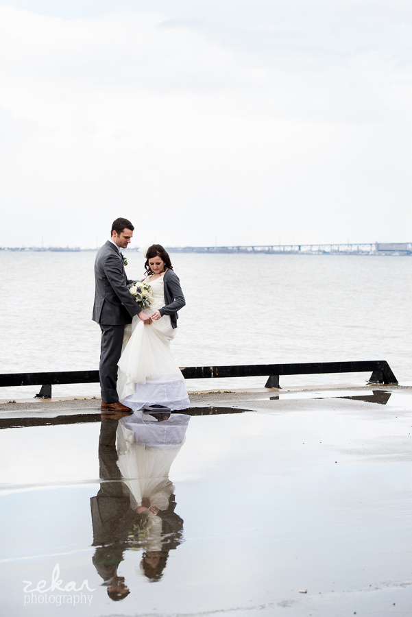 bride and groom and puddles