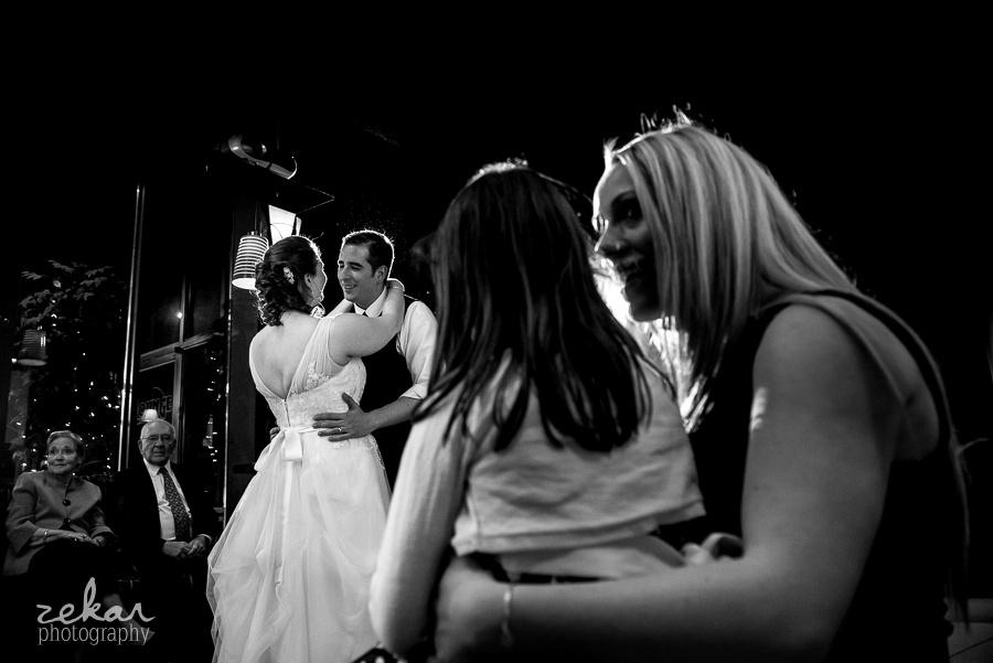 woman watching bride and groom dance