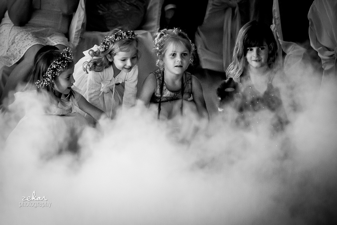 little girls playing with clouds of dry ice