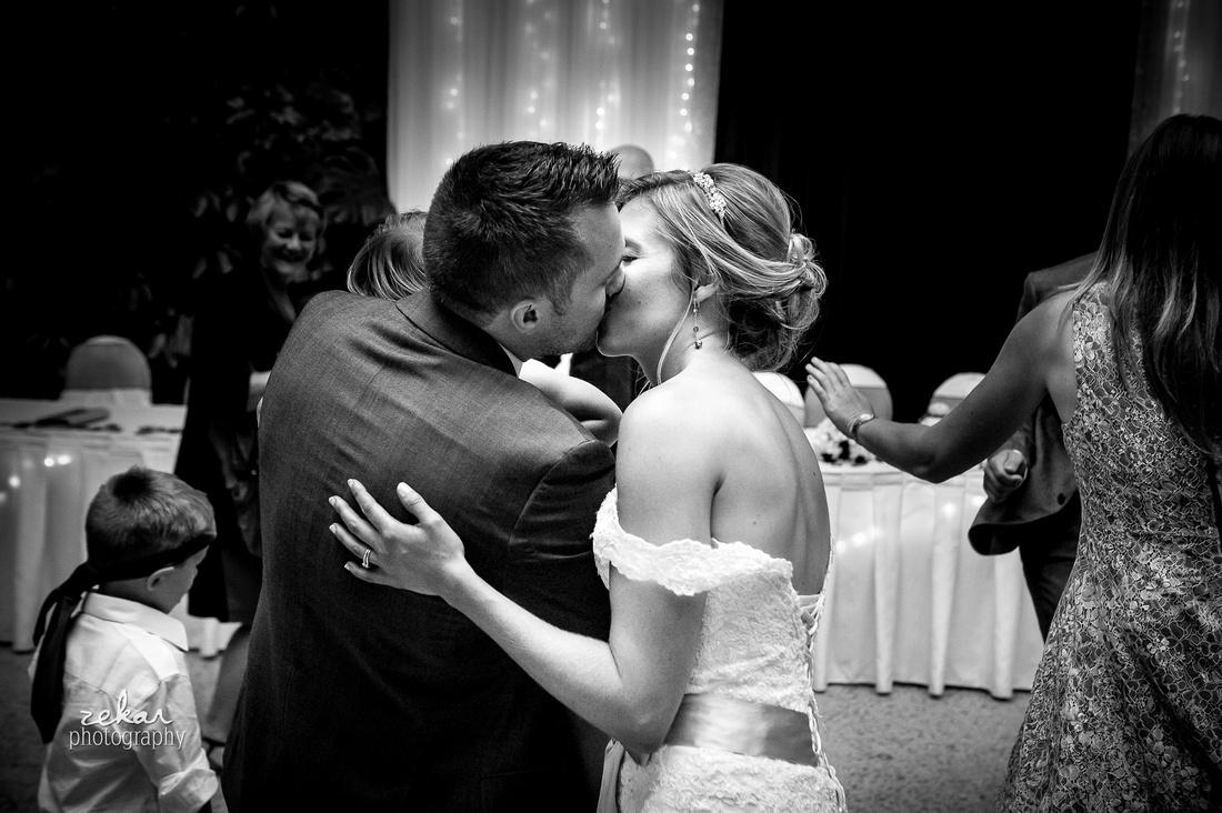 bride and groom kissing dancing