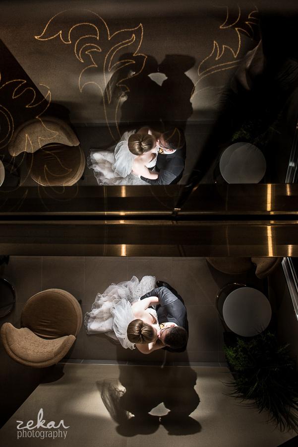 bride and groom in elevator