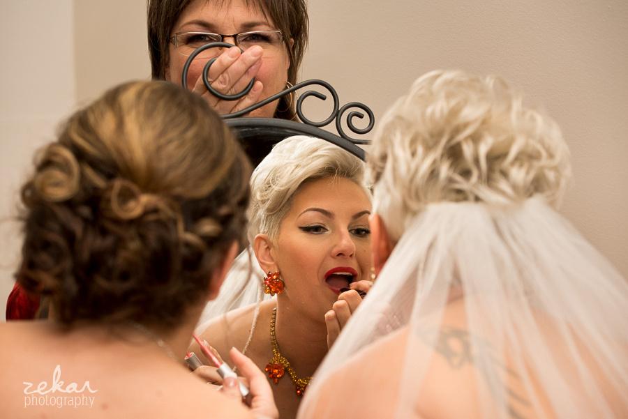 bride touching up makeup