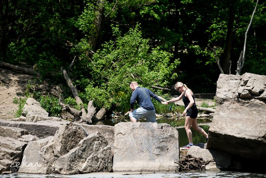 man and woman on rocks