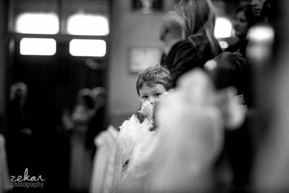 little boy peering up
