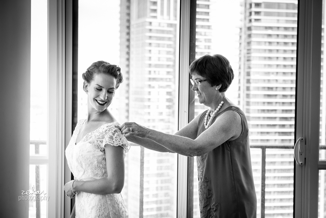 mother helping daughter get ready