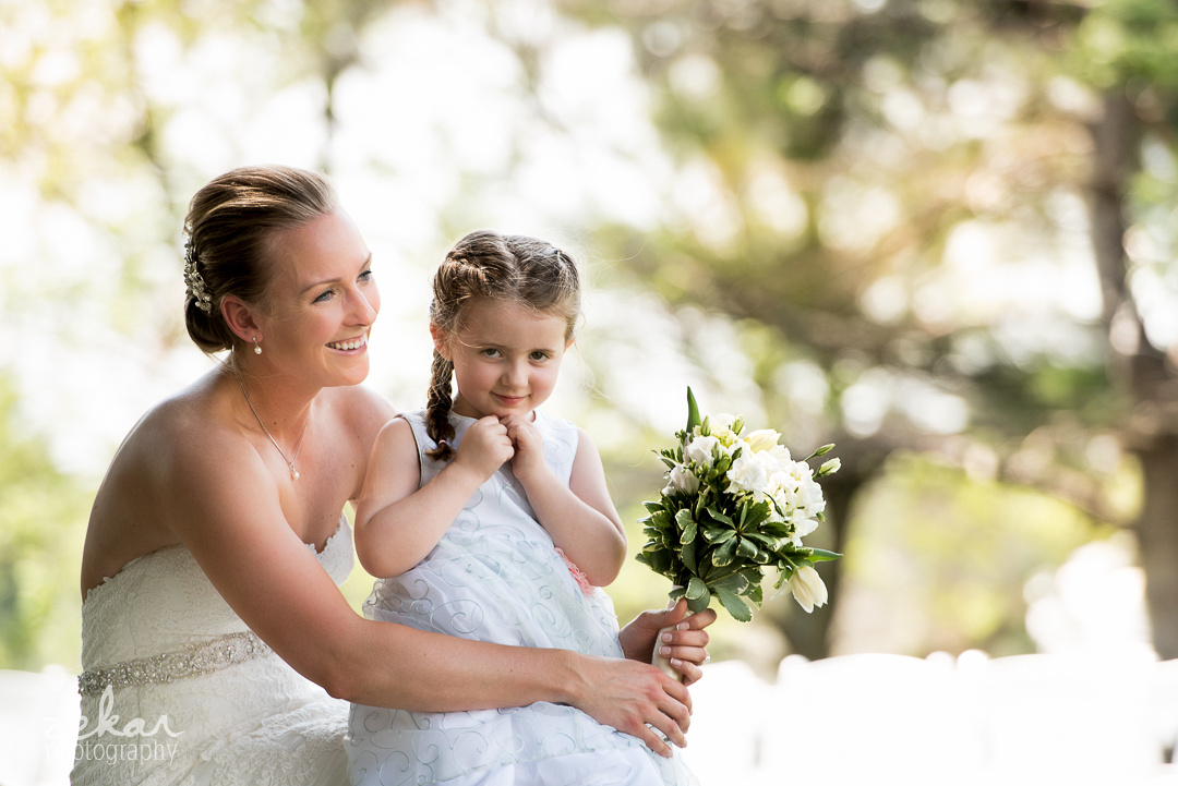 bride waiting with flower girl