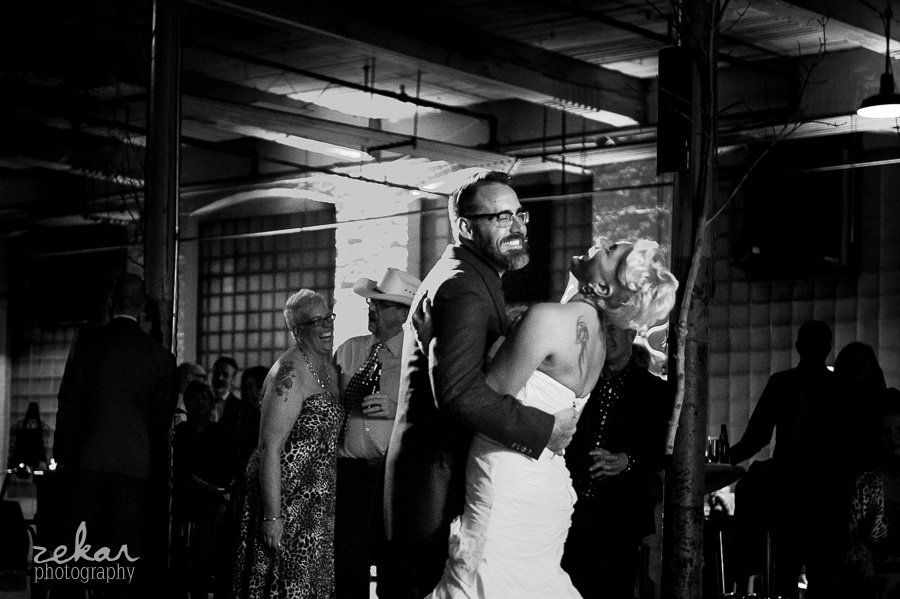 bride and groom laughing at first dance