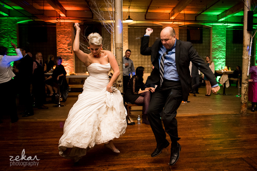 bride and friend dancing