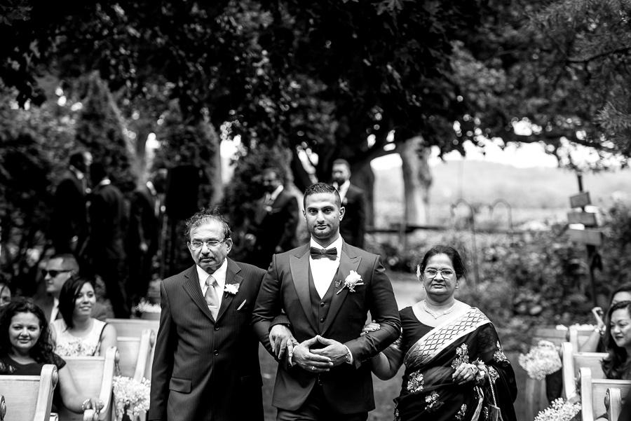 groom walking up aisle