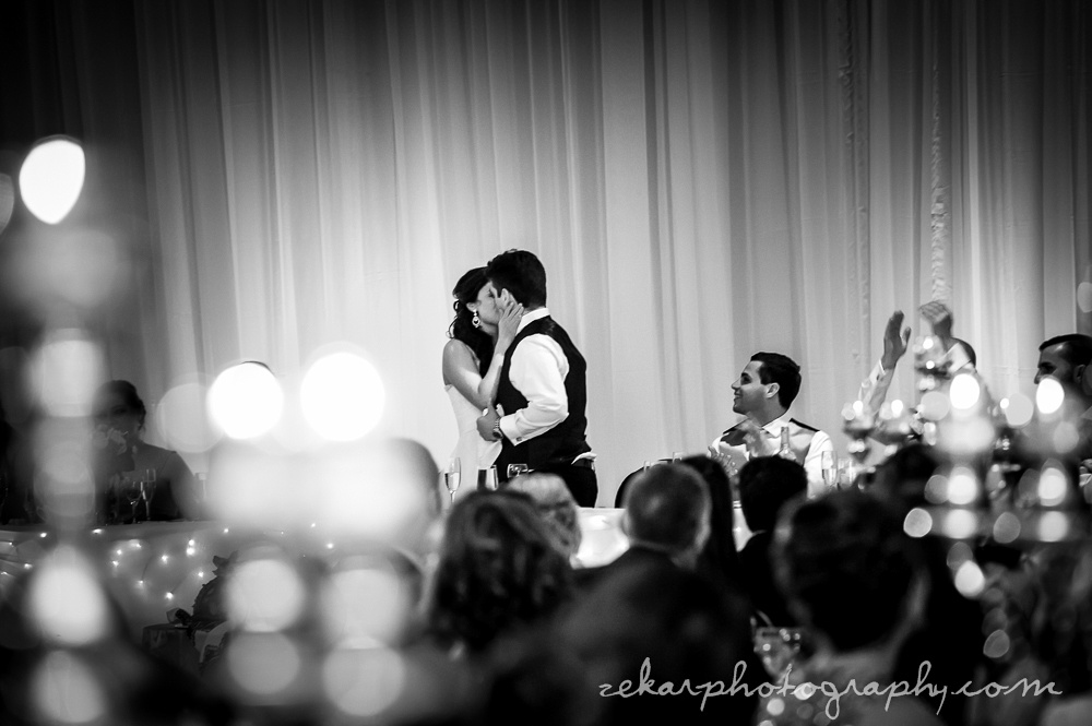 black and white photo of bride and groom first dance