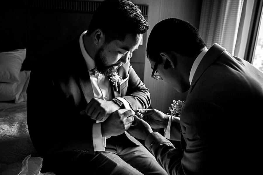 friend helping groom