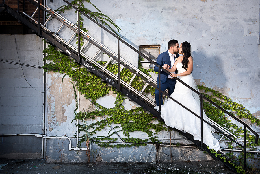 bride and groom on escape ladder
