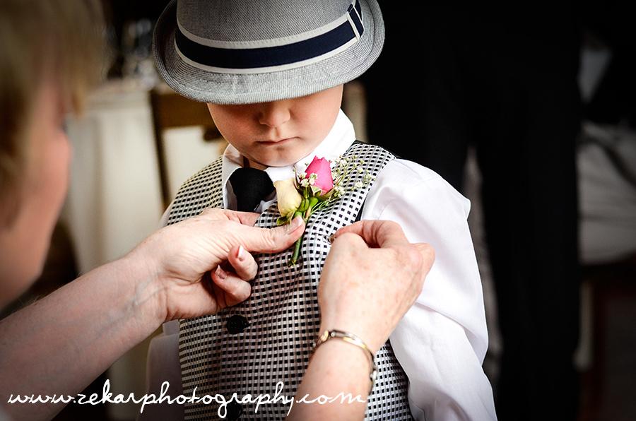 ring boy getting flower pinned on