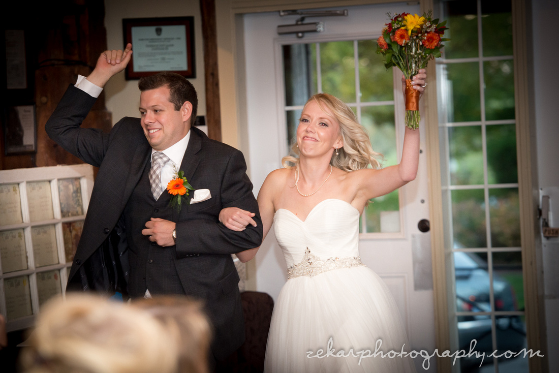 bride and groom coming in to hall