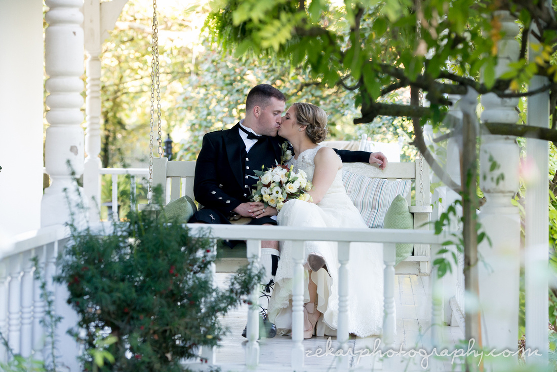 bride and groom on porch swing