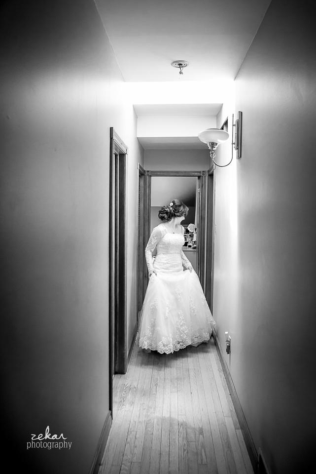 bride walking down hallway black and white