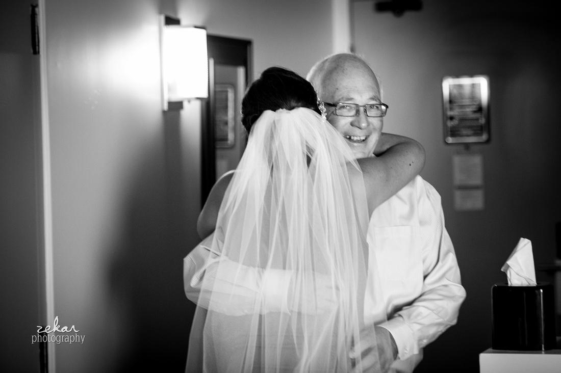 dad hugging daughter on wedding day