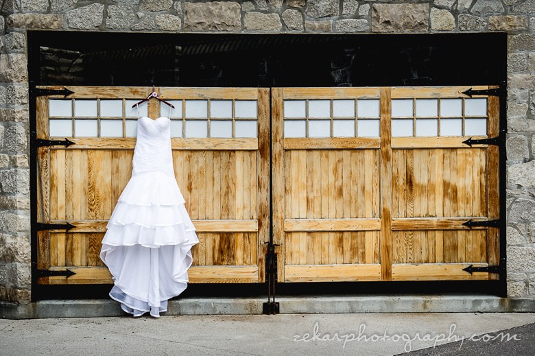 bridal gown hanging on wooden doors