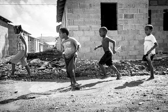 black and white photo of kids in mud