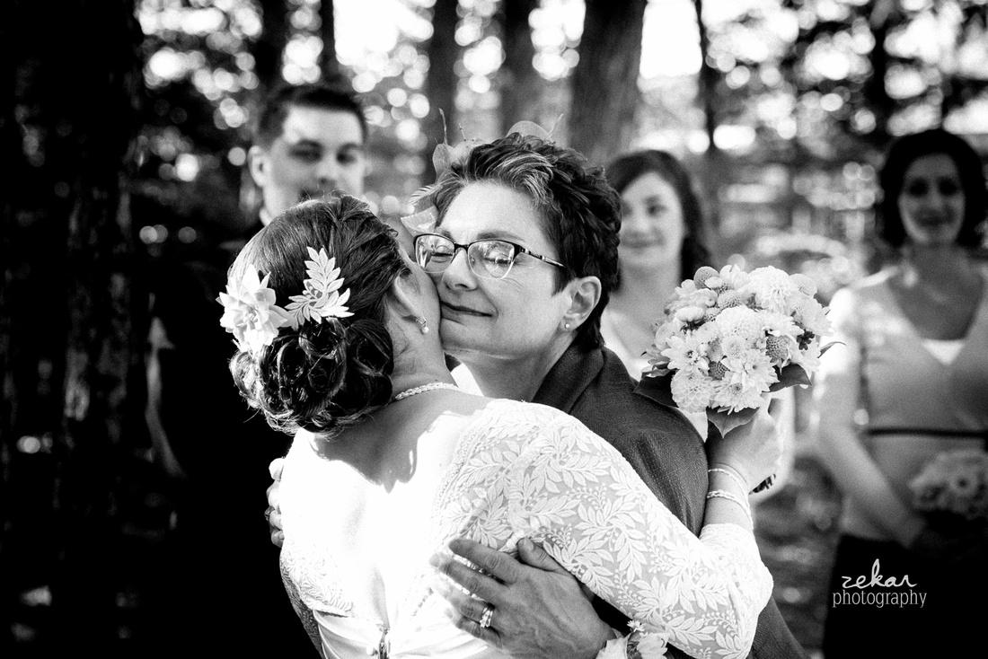 mom kissing daughter at altar