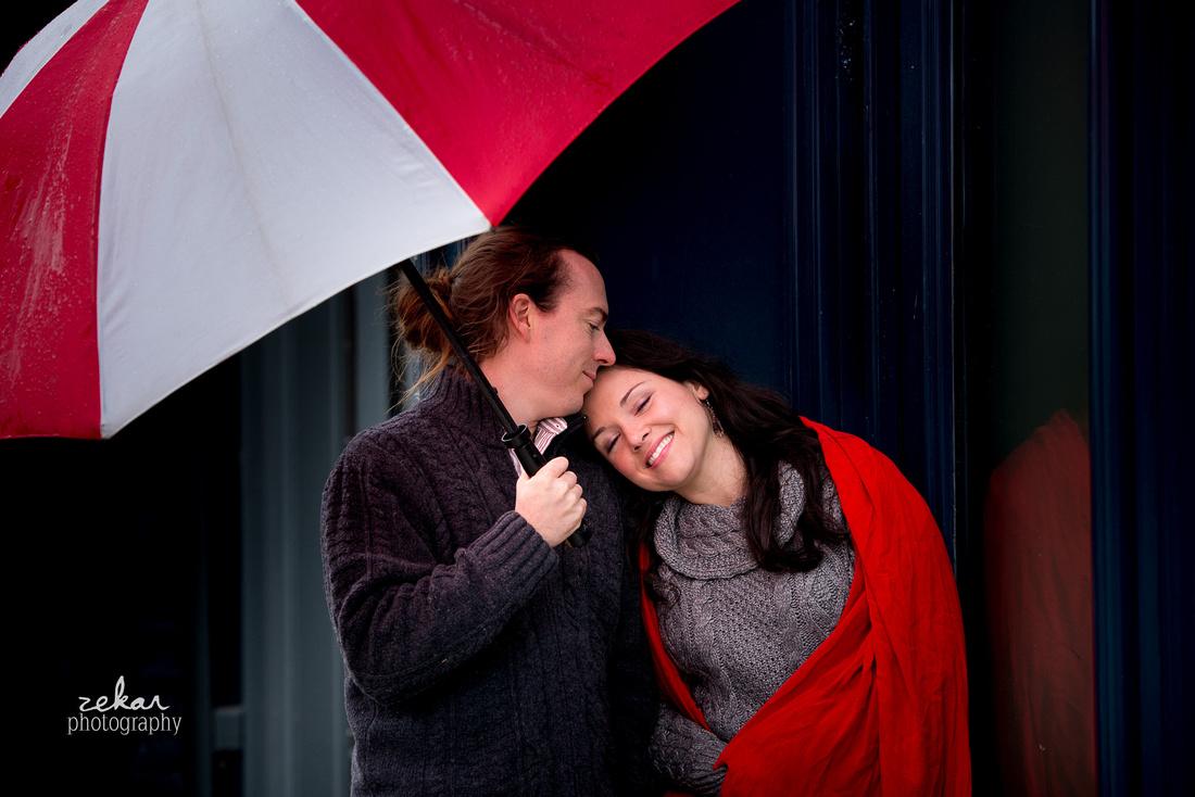 couple snuggling in the rain
