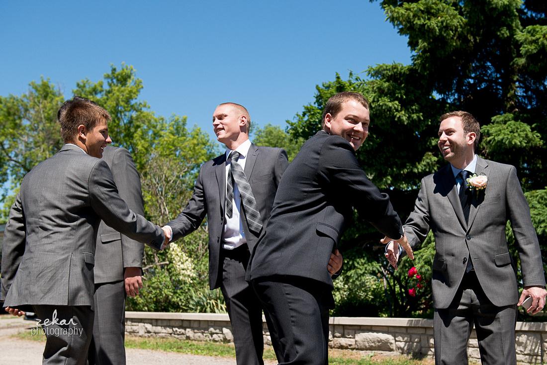 groomsmen shaking hands