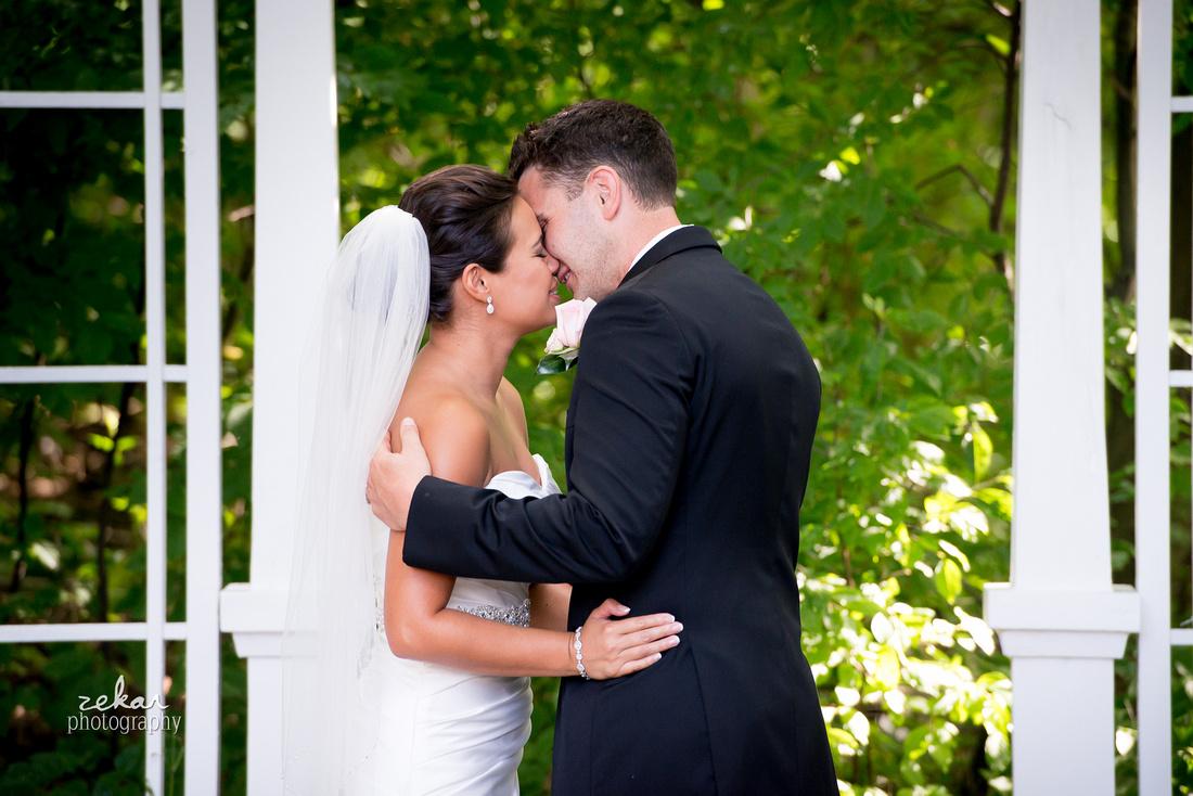 bride kisses groom at altar