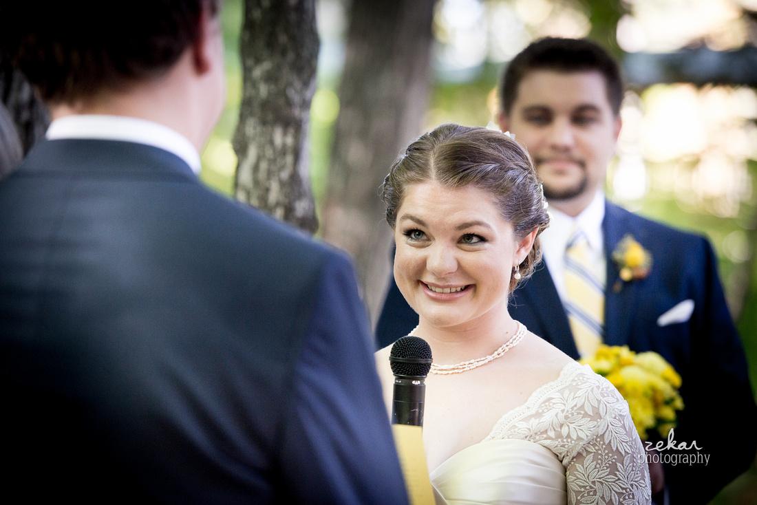 bride looking at groom altar