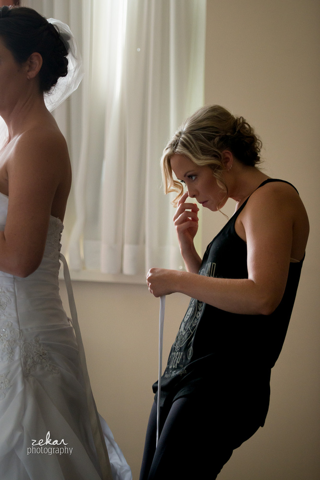 bridesmaid concentrating on dress
