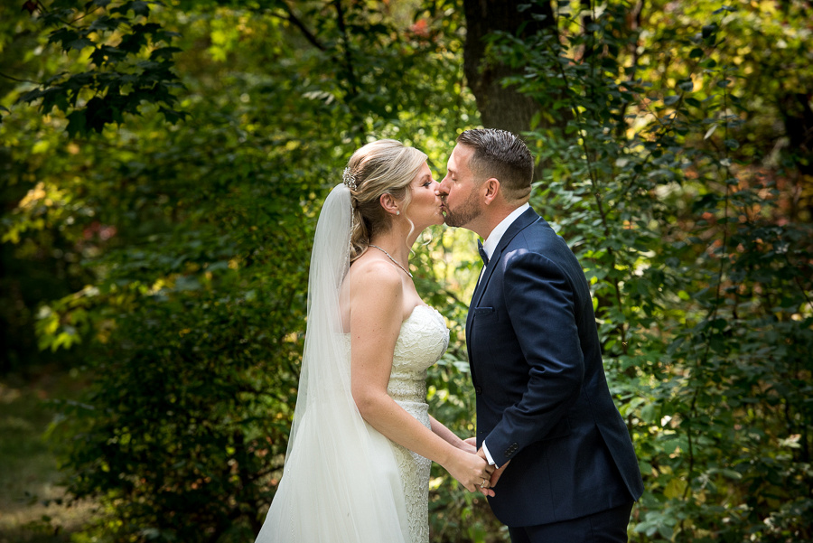 emotional bride and groom first look