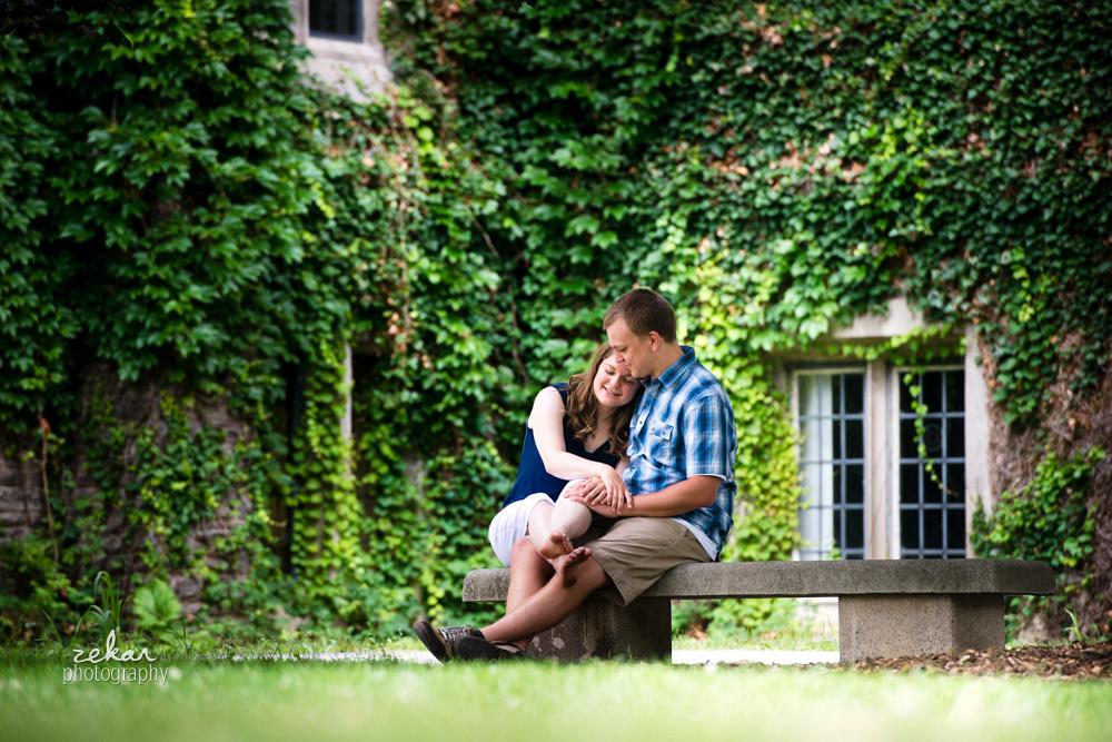 couple cuddling on bench