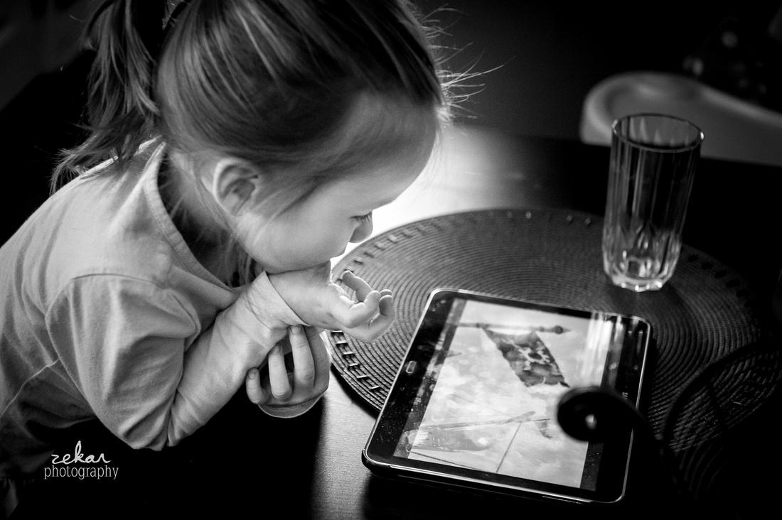 little girl looking at ipad