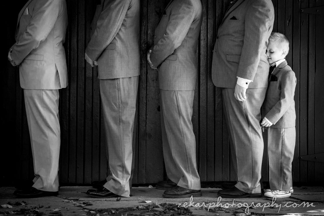 funny groomsmen wedding photograph with ring bearer