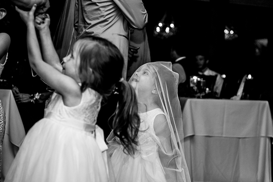 flower girls playing with veil