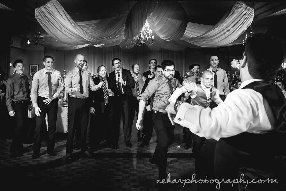 groomsmen fighting for garter
