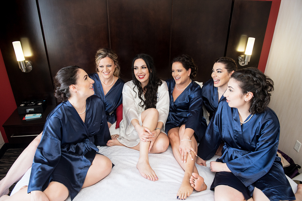bridal party on bed