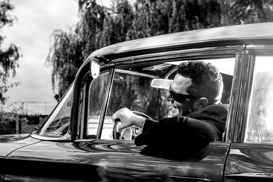 groom in classic car