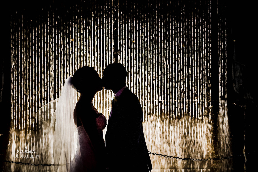 kissing beside waterfall