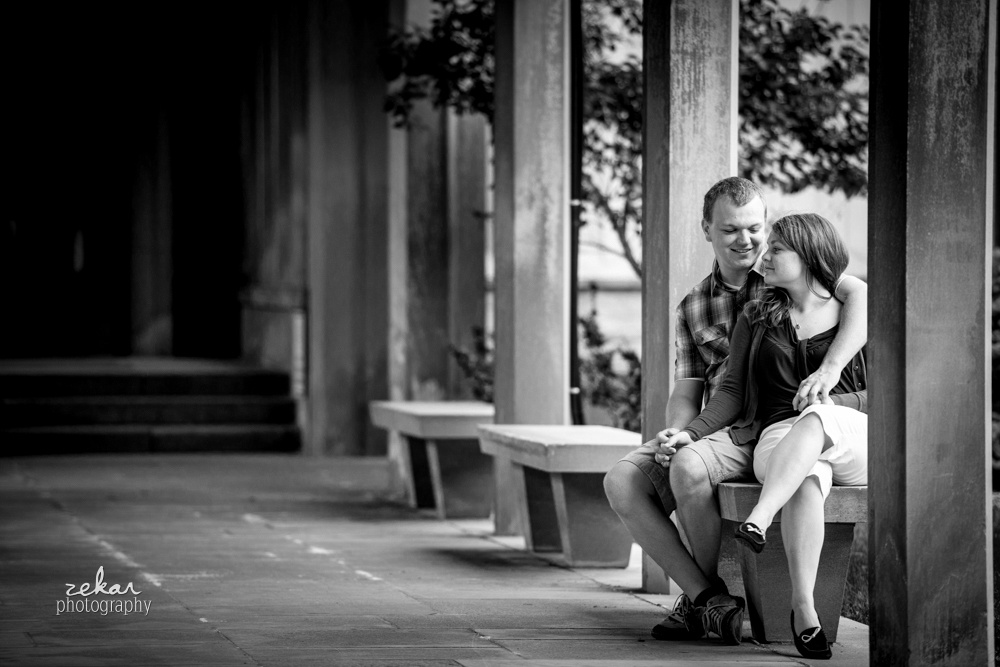 black and white photo of couple in architecture